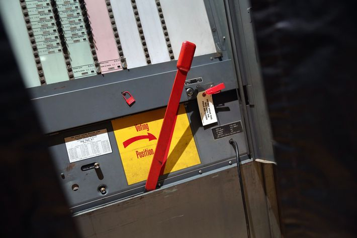 A manual voting machine awaits voters to cast their ballots in the mayoral primary election on September 10, 2013 in the Manhattan borough of New York City. Voters had a wide range of candidates to choose from in a primary vote ahead of the upcoming election to replace outgoing Mayor Michael Bloomberg.