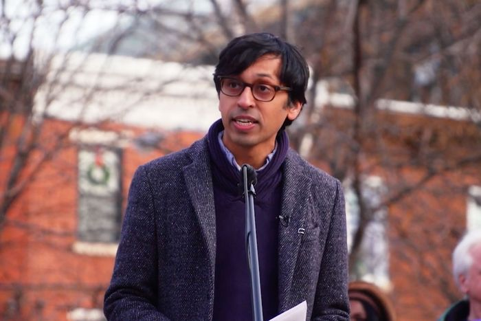 A portrait of Nikil Saval addressing a crowd, mid speech