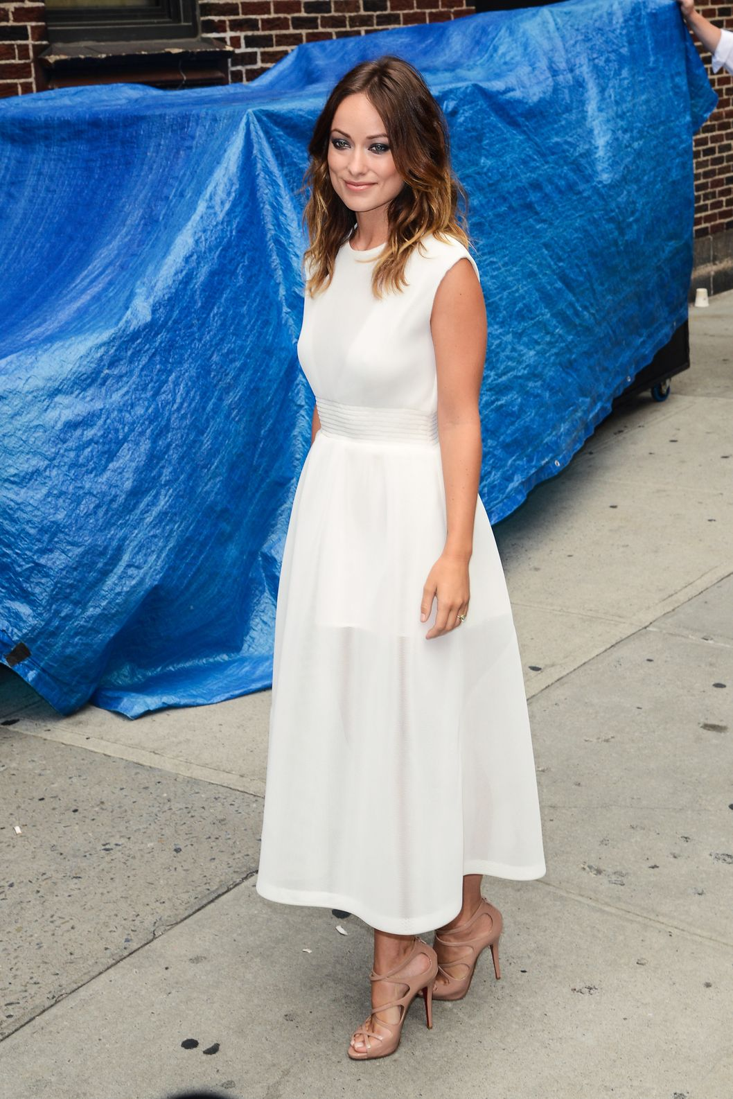 "Actress Olivia Wilde enters the ""Late Show With David Letterman"" taping at the Ed Sullivan Theater on August 19, 2013 in New York City."