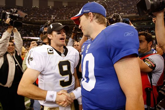NEW ORLEANS - OCTOBER 18:  Drew Brees #9 of the New Orleans Saints is congratulated by Eli Manning #10 of the New York Giants after the Saints defeated the Giants 48-27  at the Louisiana Superdome on October 18, 2009 in New Orleans, Louisiana.  (Photo by Chris Graythen/Getty Images) *** Local Caption *** Drew Brees;Eli Manning