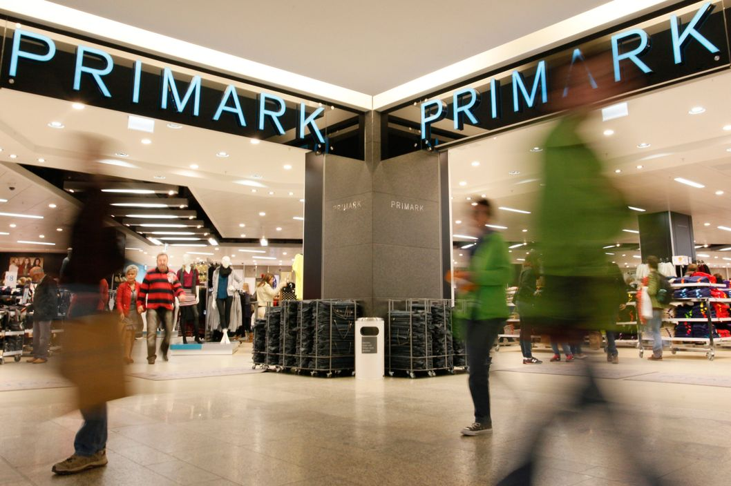 Shoppers exit a Primark store, operated by Associated British Foods Plc, in Berlin, Germany, on Friday, Sept. 28, 2012. Founded in Dublin as Penneys in 1969, Primark generates more than 3 billion pounds in annual sales from 238 stores, employing about 40,000 people in seven countries. Photographer: Michele Tantussi/Bloomberg via Getty Images