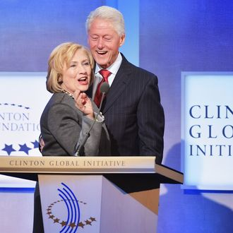 Former US Secretary of State Hillary Clinton and husband, Former U.S. President Bill Clinton address the audience during the Opening Plenary Session: Reimagining Impact for the Clinton Global Initiative on September 22, 2014 at the Sheraton New York Hotel & Towers in New York City. (Photo by Michael Loccisano/Getty Images)