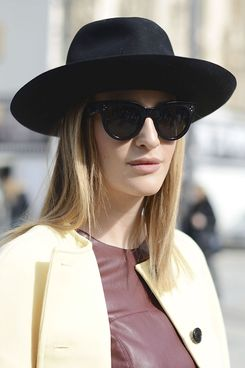 A stylish showgoer in a Borsalino hat.