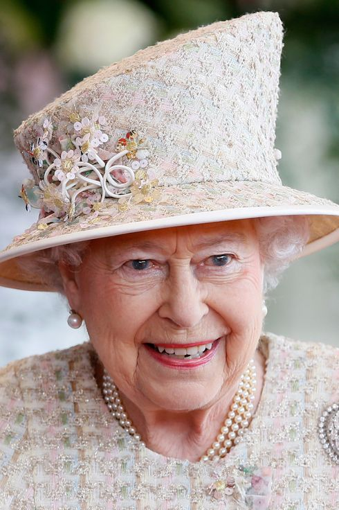 Britain's Queen Elizabeth II smiles as she attends an official welcome for the state visit of Emirati President Sheikh Khalifa bin Zayed al-Nahayan in the grounds of Windsor Castle, Berkshire, west of London on April 30, 2013. Sheikh Khalifa officially began a State visit to Britain with a cermonial welcome in Windsor hosted by the Queen and the Duke of Edinburgh.