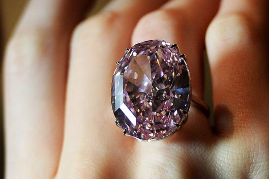 A model wears the Pink Star diamond at Sotheby's auction house in London, Britain, 24 October 2013. The Pink Star, a 59.60 carat vivid pink diamond, is considered the most valuable diamond ever to be offered at auction. The jewel is expected to fetch USD 60 million at auction in Geneva on 13 November.