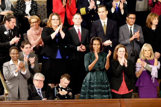 First Lady Michelle Obama and guests applaud during President Barack Obama State of the Union address on Capitol Hill in Washington, Tuesday Jan. 28, 2014. Jill Biden with her left arm in a cast is at far right. (AP Photo/J. Scott Applewhite)