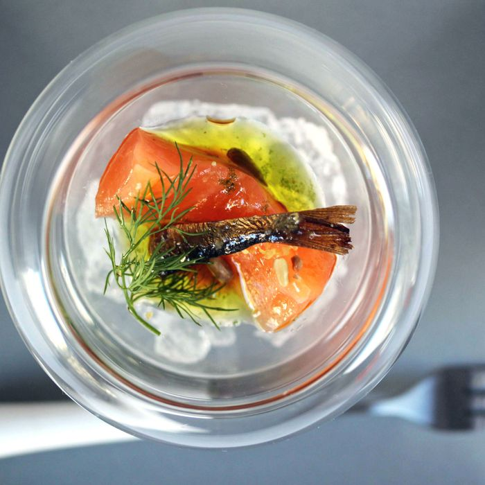 Sea-salt-cured salmon, with sunflower oil, smoked sprat with chile, sunflower seeds, and soy paste.
