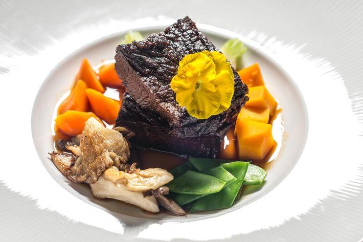 Sake-braised short rib with pan-seared foie gras, oyster mushrooms, and sugar snap peas.