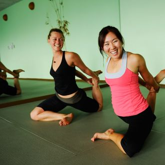 LPGA player In-Kyung Kim (R) poses in a yoga position during a feature photo shoot on August 16, 2010 in San Diego, California.