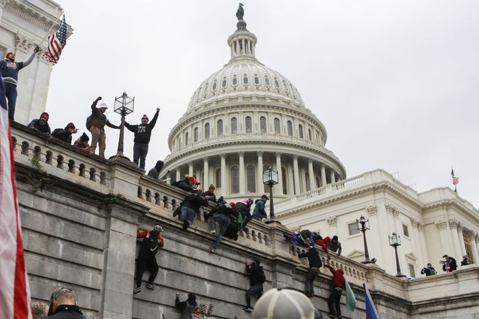 Supporters of President Donald Trump climb on the walls at the U.S. Capitol during a protest against the certification of the 2020 U.S. presidential election results by the U.S. Congress, in Washington, D.C.