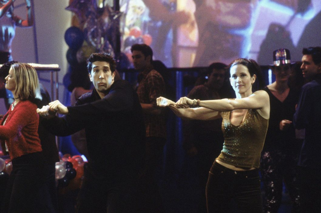 "FRIENDS -- ""The One With The Routine"" -- Episode 10 -- Aired 12/16/1999 -- Pictured: (l-r) David Schwimmer as Ross Geller, Courteney Cox as Monica Geller."