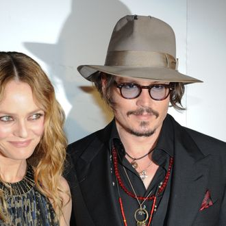 French actress Vanessa Paradis (L) and her husband, US actor Johnny Depp (R) arrive to attend the Figaro Madame/Chanel dinner during the 63rd Cannes Film Festival on May 18, 2010 in Cannes. AFP PHOTO / MARTIN BUREAU (Photo credit should read MARTIN BUREAU/AFP/Getty Images)