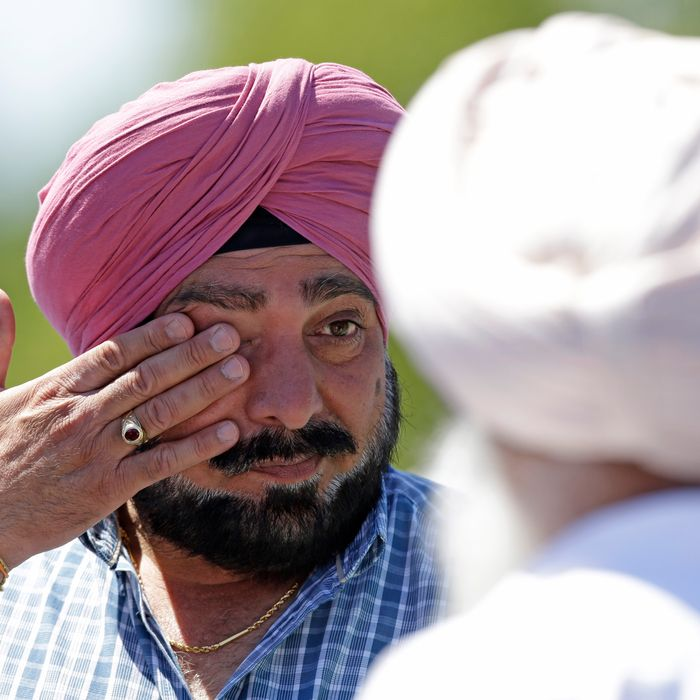 A man wipes away tears outside the Sikh Temple in Oak Creek, Wis. where a shooting took place on Sunday, Aug 5, 2012. A man wipes away tears outside the Sikh Temple in Oak Creek, Wis. where a shooting took place on Sunday, Aug 5, 2012. (AP Photo/Jeffrey Phelps)