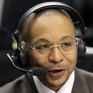Big Ten Network announcer Gus Johnson calls the game between the Penn State Nittany Lions and the Indiana Hoosiers during the first round of the 2011 Big Ten Men's Basketball Tournament at Conseco Fieldhouse on March 10, 2011 in Indianapolis, Indiana.