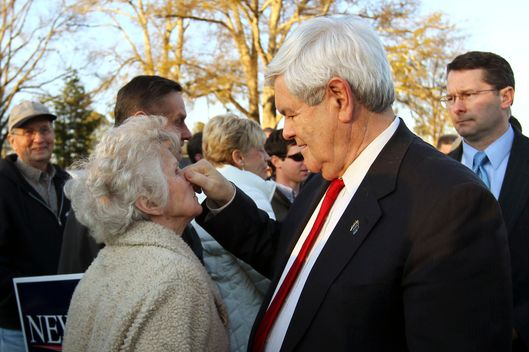 Republican presidential candidate, former House Speaker Newt Gingrich, pinches the nose of Bonnie Ellison, 78, of Easley, S.C. while shaking hands with supporters at Mutt's Barbeque in Easley, S.C. Wednesday, Jan. 18, 2012.