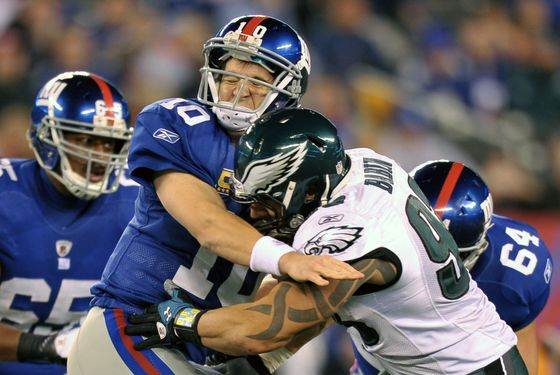EAST RUTHERFORD, NJ - NOVEMBER 20:  Eli Manning #10 of the New York Giants is hit by Jason Babin #93 of the Philadelphia Eagles at MetLife Stadium on November 20, 2011 in East Rutherford, New Jersey. (Photo by Drew Hallowell/Philadelphia Eagles/Getty Images)