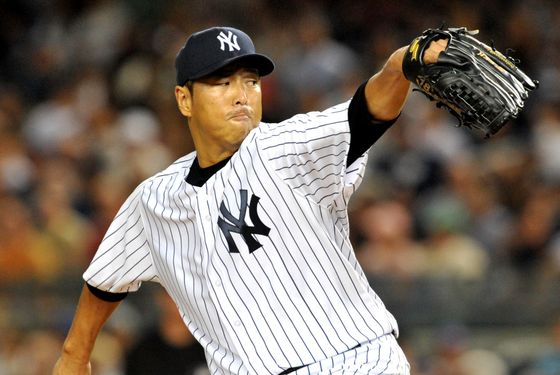 NEW YORK, NY - AUGUST 18: Hiroki Kuroda #18 of the New York Yankees pitches against the Boston Red Sox at Yankee Stadium on August 19, 2012 in the Bronx borough of New York City. (Photo by Jason Szenes/Getty Images)