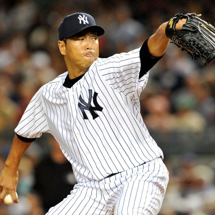 Hiroki Kuroda #18 of the New York Yankees pitches against the Boston Red Sox at Yankee Stadium on August 19, 2012 in the Bronx borough of New York City.