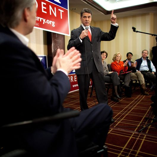 Texas Gov. Rick Perry speaks with potential voters during a caucus training session on January 3, 2012.