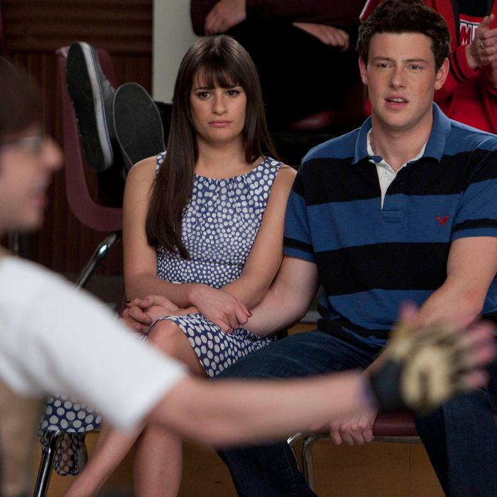 GLEE: Rachel (Lea Michele, L) and Finn (Cory Monteith, R) watch Artie perform in