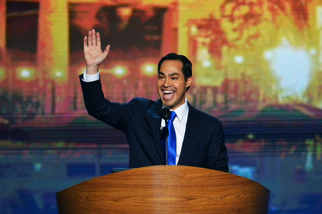 San Antonio Mayor Julian Castro waveS to the audience  at the Time Warner Cable Arena in Charlotte, North Carolina, on September 4, 2012 on the first day of the Democratic National Convention (DNC). The DNC is expected to nominate US President Barack Obama to run for a second term as president.