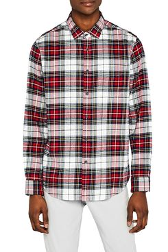 A male model wearing a men's slim-fit long sleeve red, white, yellow, and black plaid flannel with a collar and white jeans. The Strategist - A Bunch of Men's Button Downs (From $16) Are on Sale at Amazon.