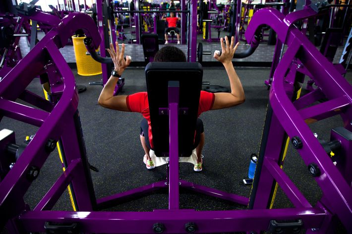 Cristina Winsor, of Wakefield, works out at Planet Fitness in Reading on Tuesday, March 19, 2013.