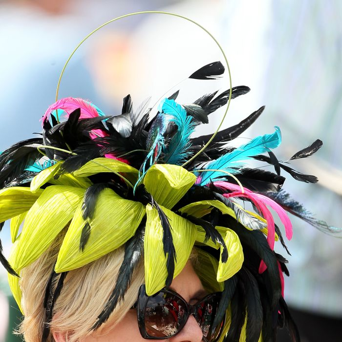 LOUISVILLE, KY - MAY 05: A horseracing fan wears a decorative hat prior to the 138th running of the Kentucky Derby at Churchill Downs on May 5, 2012 in Louisville, Kentucky. (Photo by Elsa/Getty Images)