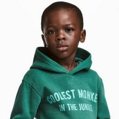 "15d3e137f H&M faced a swift and powerful backlash after photos of a sweatshirt  reading ""coolest monkey in the jungle"" modeled on a black child went viral."