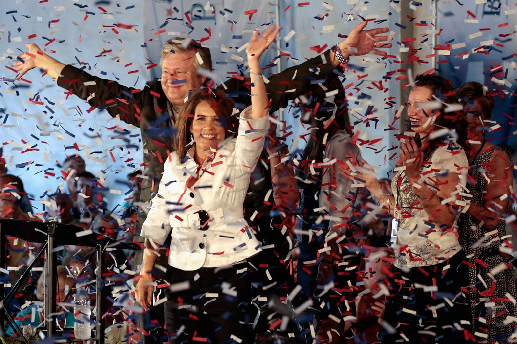 AMES, IA - AUGUST 13:  Republican presidential candidate Rep. Michele Bachmann (R-MN), her husband Marcus Bachmann and some of their children wave to supporters as confetti rains down in her tent outside the Hilton Coliseum at Iowa State University August 13, 2011 in Ames, Iowa. Nine GOP presidential candidates are competing for votes in the Iowa Straw Poll, an important step for gaining momentum in a crowded field of hopefuls.  (Photo by Chip Somodevilla/Getty Images)