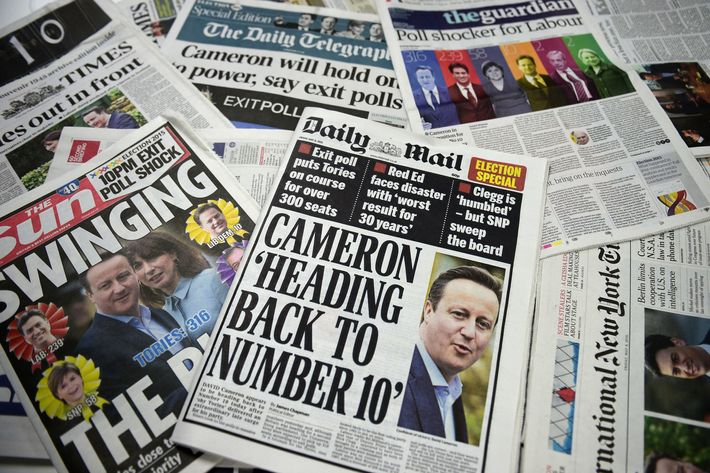 A picture of an arrangement of British newspapers carrying headlines dominated by exit poll forecasts in favour of the Conservative Party in the British general election taken in London on May 8, 2015. Prime Minister David Cameron's Conservatives are on course to be the biggest party in the next British parliament, according to an exit poll from the general election showing them winning far more seats than had been expected. AFP PHOTO / DANIEL SORABJI (Photo credit should read DANIEL SORABJI/AFP/Getty Images)