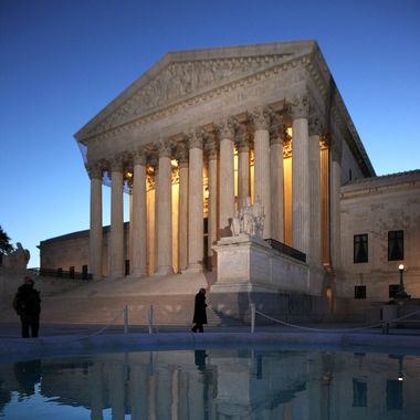 A man walks in front of the U.S. Supreme in the morning hours of March 27, 2012 in Washington, DC. The Supreme Court continued to hear oral arguments on the Patient Protection and Affordable Care Act.