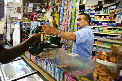 NEW YORK - JUNE 18:  Jesus Martinez works at his bodega grocery store around the corner from where Bolivar Cruz was killed while working at his bodega last week June 18, 2007 in the Queens borough of New York City. Sixteen area bodega stores in Queens have been robbed since March. While crime has dropped throughout New York City, operating a bodega is still a risky job as many clients are poor and the stores are often situated in high crime areas.  (Photo by Spencer Platt/Getty Images) *** Local Caption *** Jesus Martinez