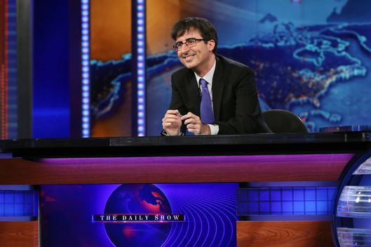"John Oliver takes over as summer guest host of ""The Daily Show with Jon Stewart"" on June 10, 2013 in New York City."