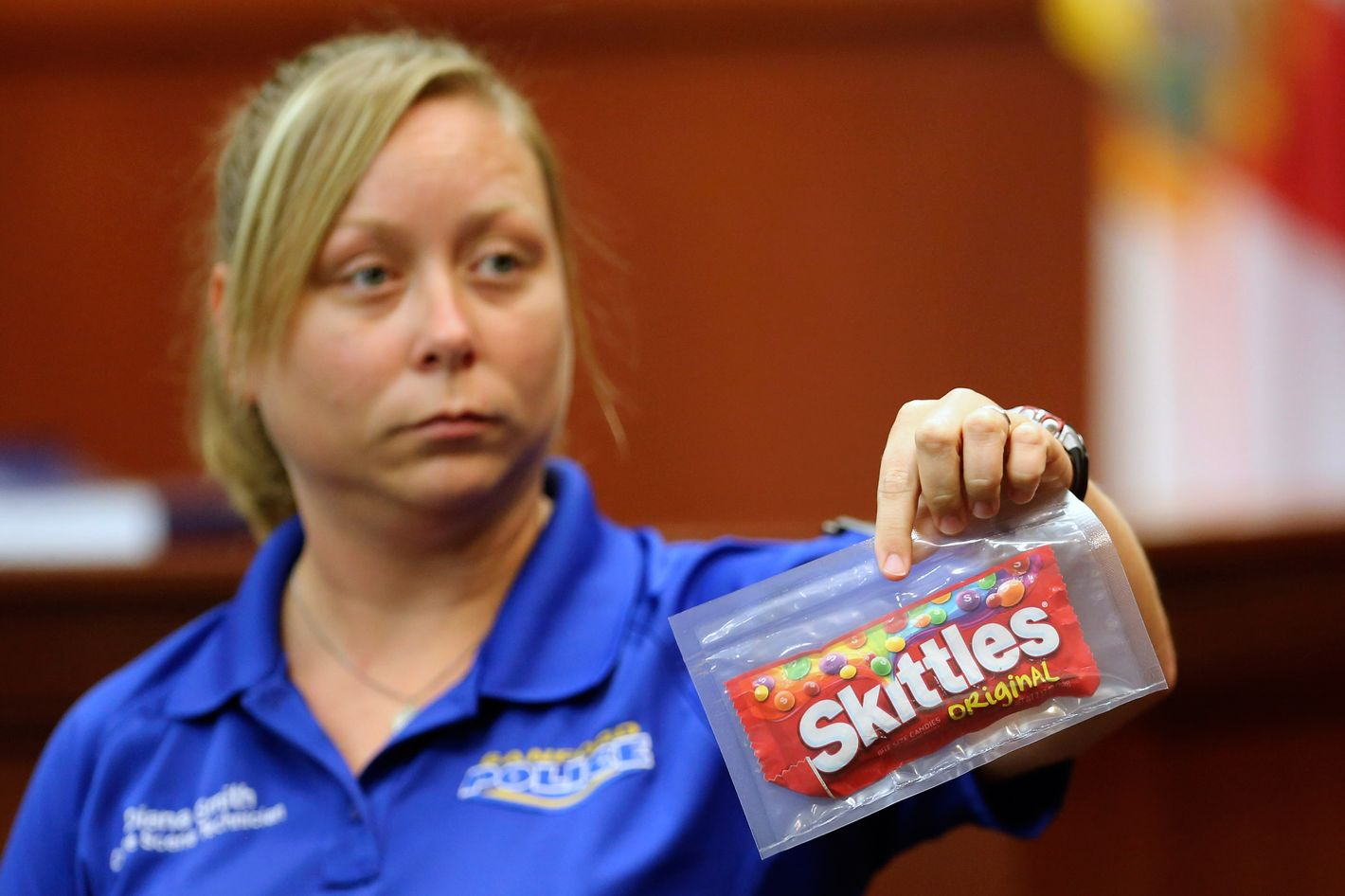 Diana Smith, crime scene technician for the Sanford Police Department, shows the jury a bag of Skittles that was collected as evidence at the crime scene, during George Zimmerman's trial in Seminole circuit court June 25, 2013 in Sanford, Florida. Zimmerman is charged with second-degree murder for the February 2012 shooting death of 17-year-old Trayvon Martin.