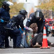 PORTLAND - NOVEMBER 13: A young protester is arrested near the Occupy Portland encampment November 13, 2011 in Portland, Oregon. Portland police have reclaimed the two parks in which occupiers have been camping after a night of brinksmanship with protesting crowds of several thousands. (Photo by Natalie Behring/Getty Images)