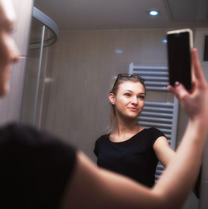 Woman taking a selfie.