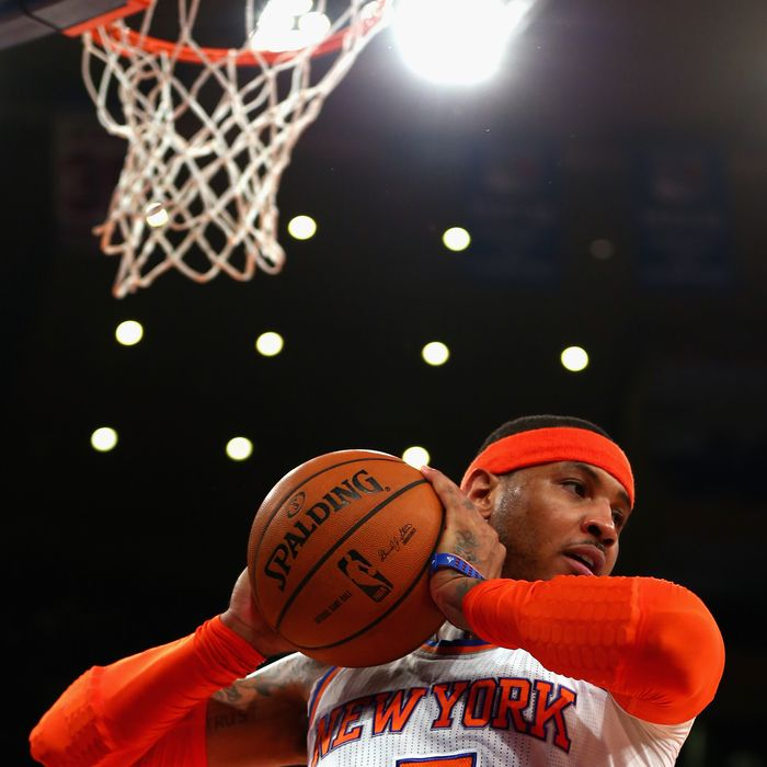 NEW YORK, NY - MAY 16: Carmelo Anthony #7 of the New York Knicks rebounds the ball against the Indiana Pacers during Game Five of the Eastern Conference Semifinals of the 2013 NBA Playoffs at Madison Square Garden on May 16, 2013 in New York City. NOTE TO USER: User expressly acknowledges and agrees that, by downloading and or using this photograph, User is consenting to the terms and conditions of the Getty Images License Agreement. (Photo by Elsa/Getty Images)