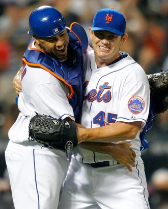 NEW YORK, NY - AUGUST 09: Catcher Ronny Paulino celebrates with reliever Jason Isringhausen #45 of the New York Mets after the last out of the game to give Jason his sixth save of the season in a Major League Baseball game against the San Diego Padres at Citi Field on August 9, 2011 in the Flushing neighborhood of the Queens borough of New York City. (Photo by Paul Bereswill/Getty Images)