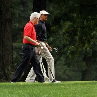 JOINT BASE ANDREWS, MD - SEPTEMBER 24: Former U.S. President Bill Clinton (L) and U.S. President Barack Obama chat after completing the first hole during a golf game September 24, 2011 at Joint Base Andrews, Maryland. They were also joined by Obama's Chief of Staff William Daley and Clinton's adviser Doug Band. (Photo by Chris Kleponis-Pool/Getty Images)