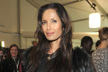 Padma Lakshmi poses backstage at the Naeem Khan Fall 2012 fashion show during Mercedes-Benz Fashion Week at The Theatre at Lincoln Center on February 14, 2012 in New York City.