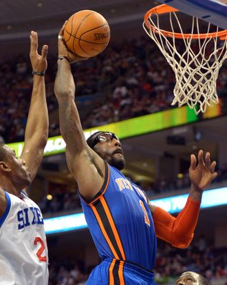 Amare Stoudemire #1 of the New York Knicks dunks on Thaddeus Young #21 of the Philadelphia 76ers at the Wells Fargo Center on March 21, 2012 in Philadelphia, Pennsylvania.