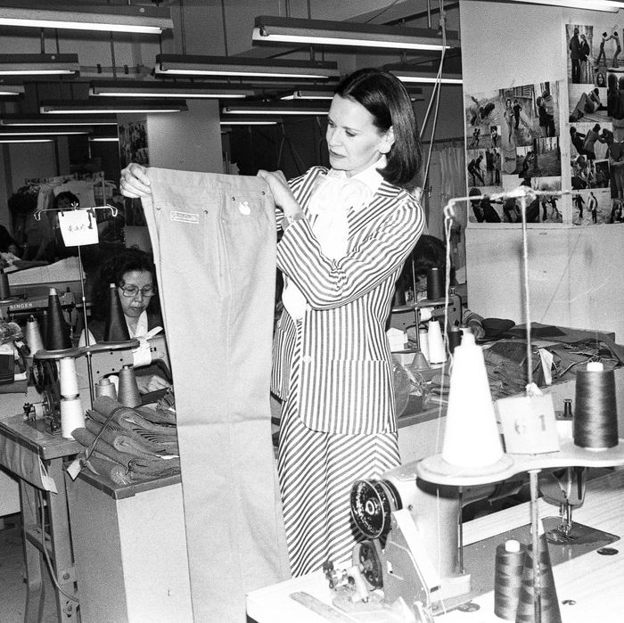 Gloria Vanderbilt, inspecting her jeans at the factory where they were made.