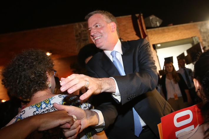 NEW YORK, NY - SEPTEMBER 10: Democratic candidate for mayor and Public Advocate Bill de Blasio (C) greets the crowd while arriving at his primary night party on September 10, 2013 in the Brooklyn borough of New York City. De Blasio is leading the Democratic race, according to exit polls. (Photo by Mario Tama/Getty Images)