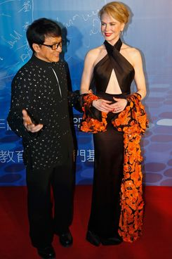 Actress Nicole Kidman, right,  and Hong Kong action star Jackie Chan arrive at the 10th Huading Awards ceremony in Macau Monday, Oct. 7, 2013.