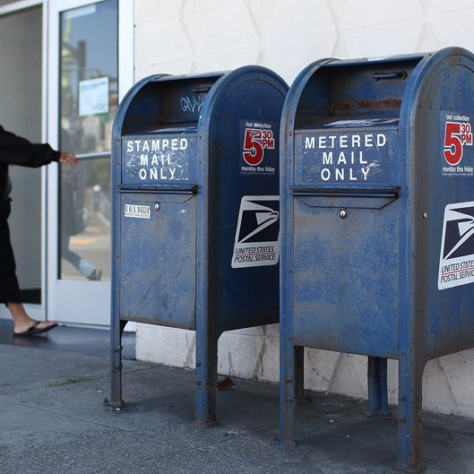 A U.S. Postal Service customer enters the Bayview Station on July 26, 2011 in San Francisco, California.  The U.S. Postal Service announced plans to cut up to 3,700 of its 32,000 post offices across the country as they seek ways to cut financial losses as mail volume dwindles.