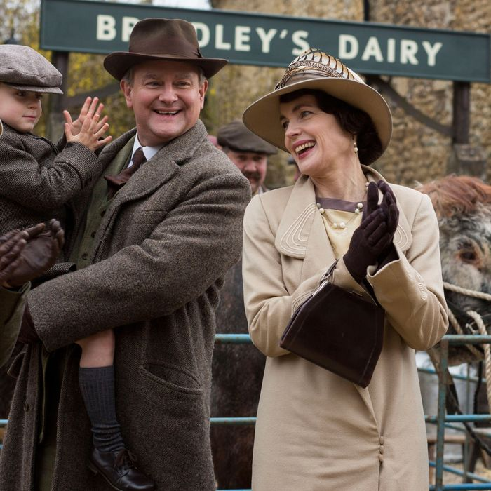 Downton AbbeyPart Two - Sunday, January 10, 2016 at 9pm ET on MASTERPIECE on PBSWedding plans hit a snag. Pigs lead to trouble for Edith and Marigold. Thomas gets a hint. Anna has a secret appointment. Violet and Isobel lock horns over health care. Shown from left to right: Laura Carmichael as Lady Edith, Oliver/Zac Barker as Master George, Hugh Bonneville as Lord Grantham, and Elizabeth McGovern as Cora (C) Nick Briggs/Carnival Film & Television Limited 2015 for MASTERPIECE This image may be used only in the direct promotion of MASTERPIECE CLASSIC. No other rights are granted. All rights are reserved. Editorial use only. USE ON THIRD PARTY SITES SUCH AS FACEBOOK AND TWITTER IS NOT ALLOWED.