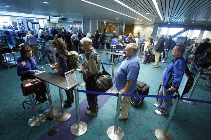 In this April 30, 2012, photo shows travelers passing through the security check point at Portland International Airport, in Portland, Ore. Airport security procedures, with their intrusive pat downs and body scans, don't need to be toughened despite the discovery of a new al-Qaida airline bomb plot using more sophisticated technology than an earlier attempt, congressional and security officials said Tuesday. (AP Photo/Rick Bowmer)