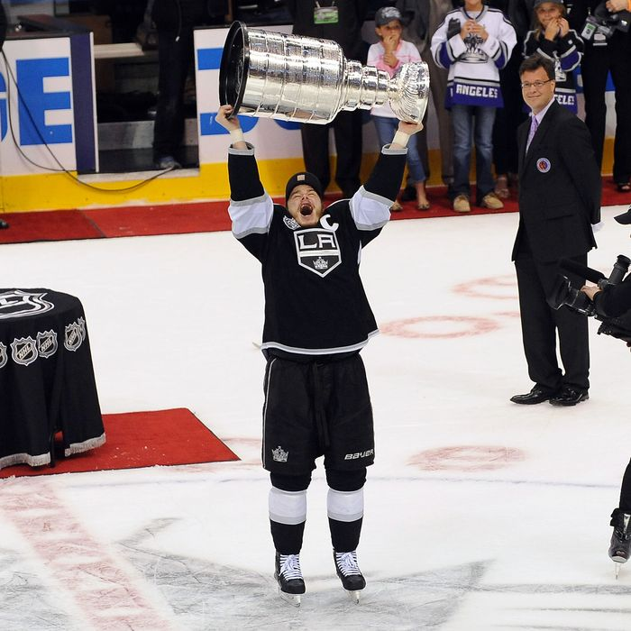 Dustin Brown #23 of the Los Angeles Kings raises the Stanley Cup after defeating the New Jersey Devils after Game Six of the 2012 Stanley Cup Final at Staples Center on June 11, 2012 in Los Angeles, California.