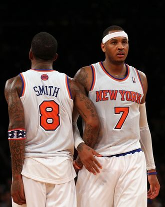 Carmelo Anthony #7 and J.R. Smith #8 of the New York Knicks celebrate a foul against the Dallas Mavericks on November 9, 2012 at Madison Square Garden in New York City.The New York Knicks defeated the Dallas Mavericks 104-94.
